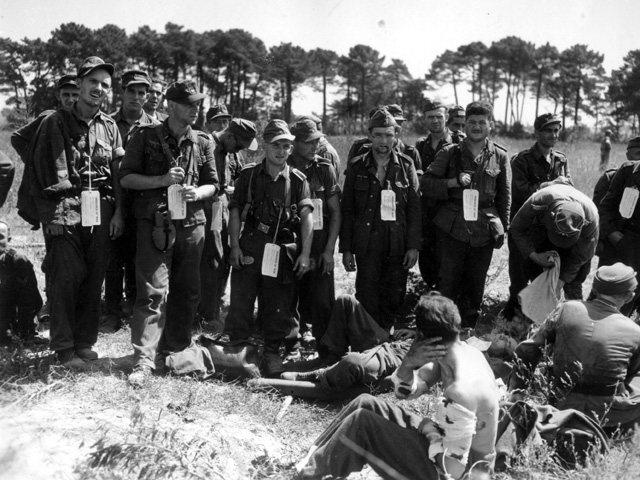 German prisoners, including wounded soldiers wait for final processing on Red Beach. In the first 24 hours, Third Division units captured more than 1,500 soldiers mostly from the 242nd Infantry Division which was later destroyed in its defense of Toulon. At the hands of the Third Division, the Germans suffered 330 killed, 1,005 wounded and 9,000 captured in the days surrounding the landings.